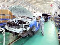 Dây chuyền lắp ráp ôtô tại nhà máy THACO (Khu kinh tế mở Chu Lai. (Ảnh: Vũ Sinh/TTXVN)