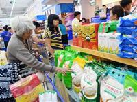 Consumers shop at a supermarket