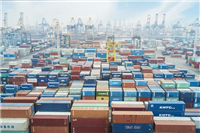 Aerial view of containers, cranes and container ships at an industrial port in Indonesia(Photo: https://www.thejakartapost.com/)